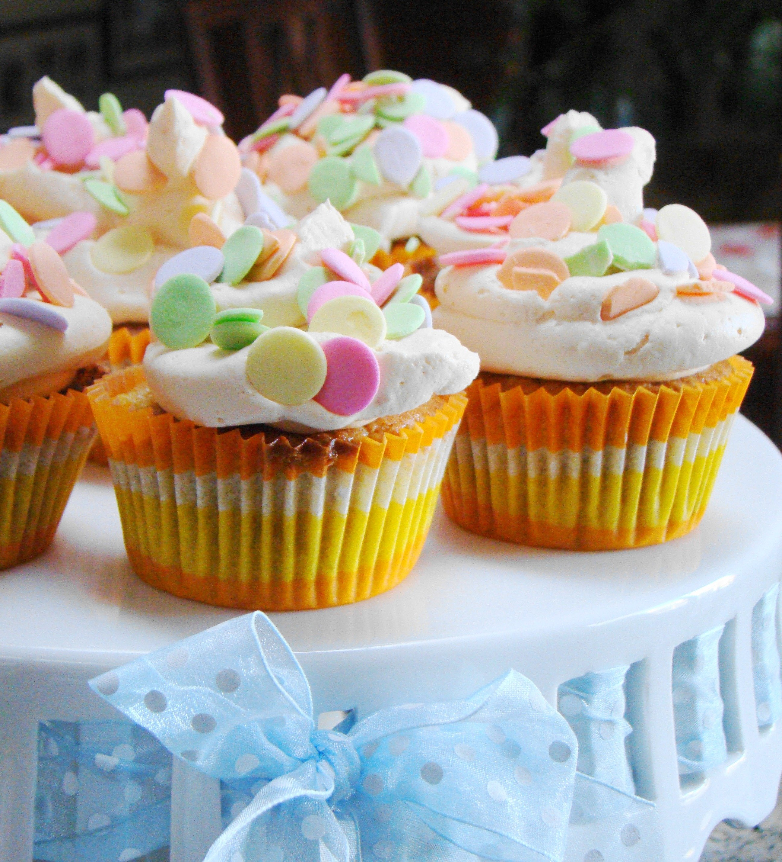 Ginger_Mango_cupcakes_with_Polka_Dots_with_blue_ribbon_in_bow